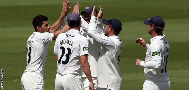 Gloucestershire bowlers celebrate