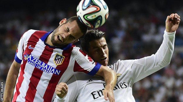 Ronaldo vies for the ball with Atletico Madrid midfielder Mario Suarez