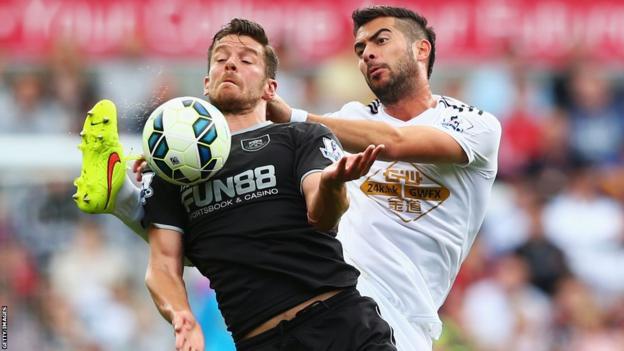 Lukas Jutkiewicz of Burnley holds off Swansea's Jordi Amat