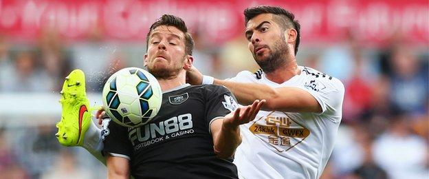 Burnley's summer signing Lukas Jutkiewicz battles for the ball with Jordi Amat