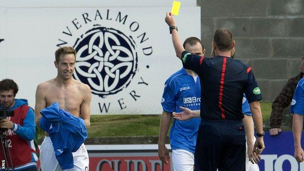 St Johnstone scorer Steven MacLean receives a yellow card for taking off his shirt as he celebrates his goal against Aberdeen