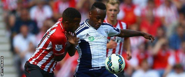 Saido Berahino of West Brom holds off a challenge from Ryan Bertrand of Southampton