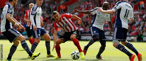 Dusan Tadic of Southampton (centre) tries to find a way through the West Brom defence