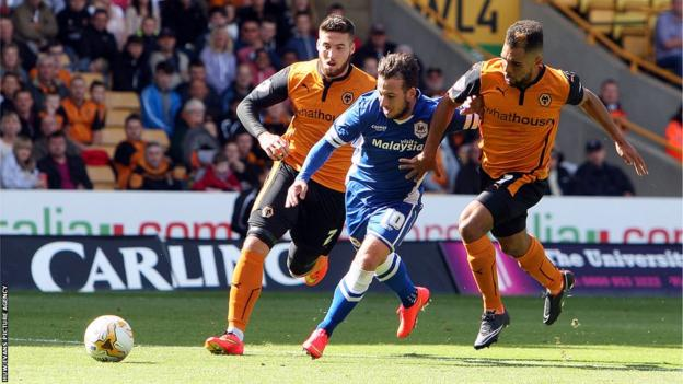 Cardiff City's Adam Le Fondre battles his way through the Wolves defence at Molineux.
