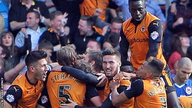 Wolves players celebrate as they beat Cardiff