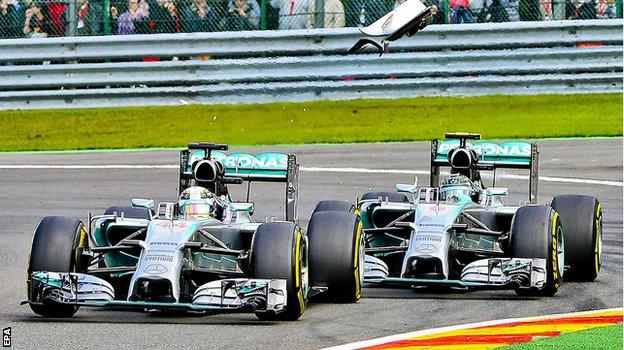 Rosberg touches the back of Hamilton's Mercedes