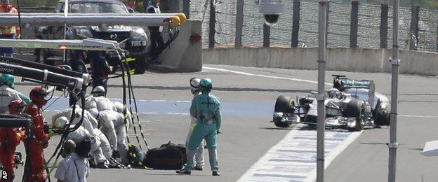 Hamilton enters the pits with his rear left tyre shredded