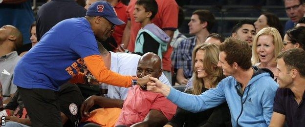 US film director Spike Lee introduces himself to Andy Murray during the basketball match at Madison Square Garden