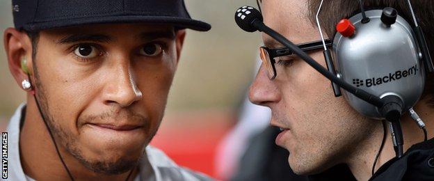 Hamilton talks to a Mercedes team-mate