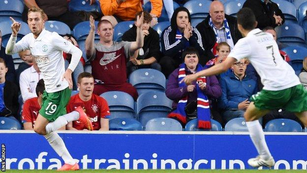 Danny Handling (left) scored and was sent off in this season's 2-1 Petrofac Training Cup loss to Rangers