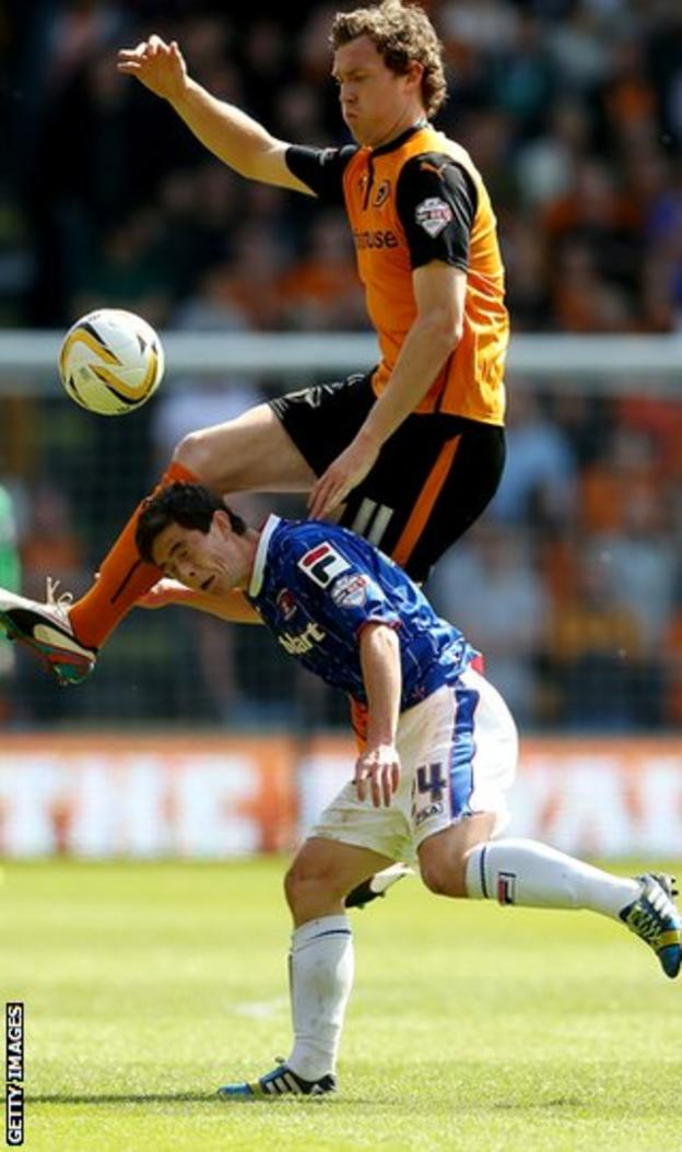 Danny Redmond tangles with Wolves' Kevin McDonald during a spell at Carlisle United