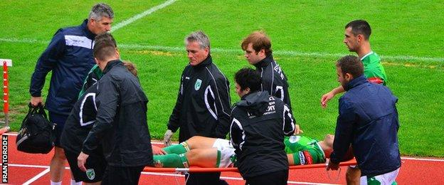 Simon Geall is stretchered off