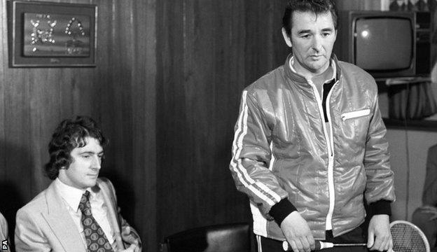 Trevor Francis watches as Brian Clough holds court with a squash racquet