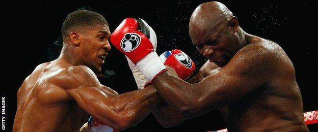 Anthony Joshua connects with a right against Matt Skelton