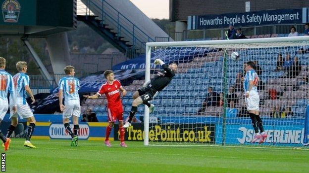 Huddersfield Town's Adam Hammill makes a goal line clearance