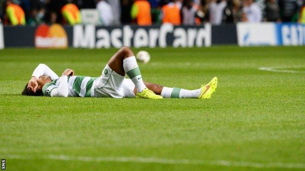 Celtic's Virgil van Dijk lies dejected after the 1-0 defeat by Maribor.