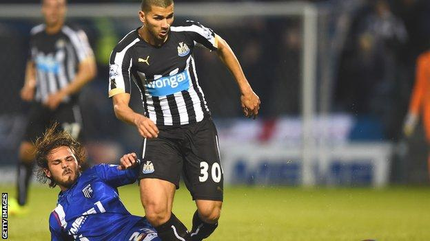 Newcastle's Mehdi Abeid tackled by Bradley Dack of Gillingham