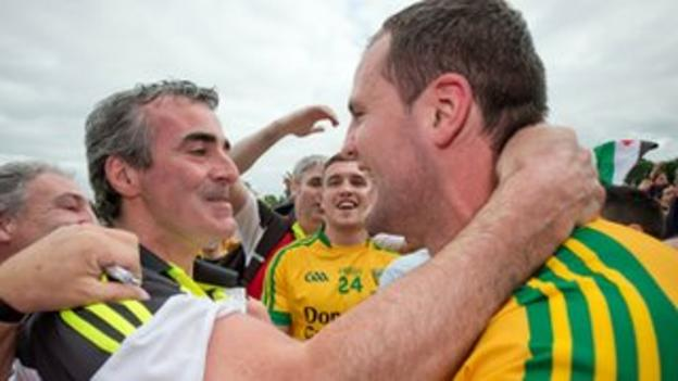Donegal manager Jim McGuinness embraces his captain Michael Murphy after Ulster title triumph