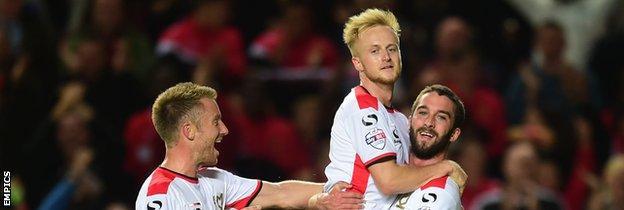 MK Dons celebrate scoring against Manchester United