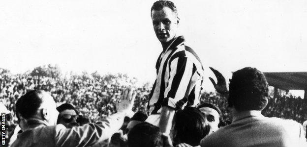 Welsh footballer John Charles is held aloft by supporters after he led his team Juventus to victory in the 1958 Italian Cup at Turin