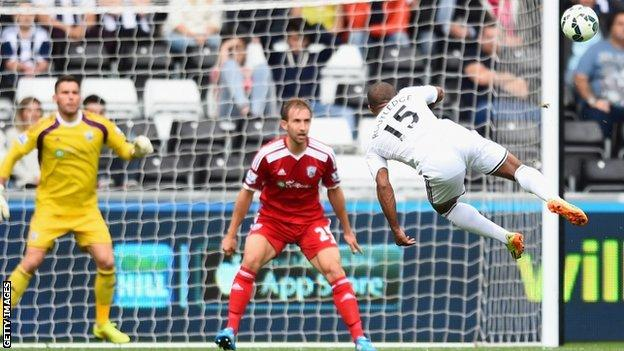 Wayne Routledge scores Swansea's second goal against West Bromwich Albion