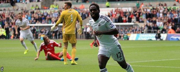 Nathan Dyer wheels away after putting Swansea ahead against West Bromwich Albion