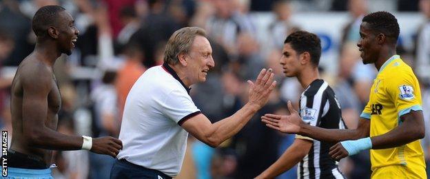 Neil Warnock greets Wilfried Zaha