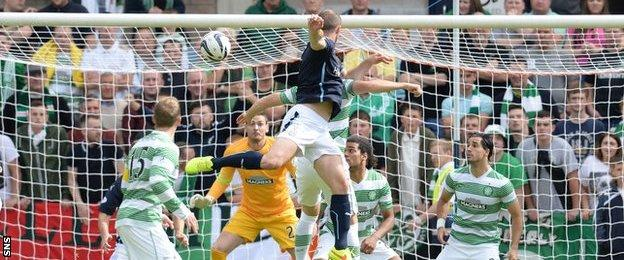 James McPake rises above the Celtic defence to give Dundee an early lead