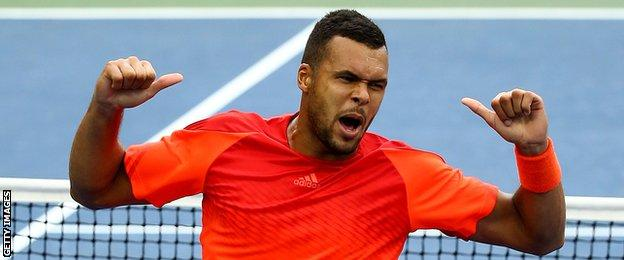 Jo-Wilfred Tsonga celebrates getting through to the fourth round of the US Open