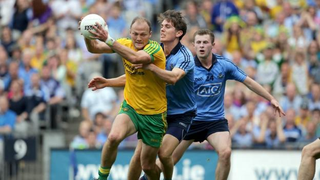 Donegal's Colm McFadden attempts to escape the attention of Dublin duo Michael Fitzsimons and Jack McCaffrey