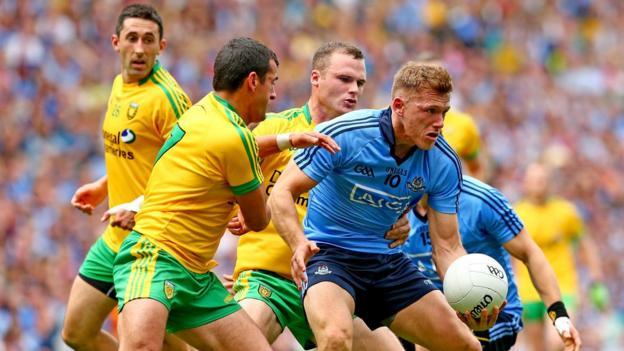 Donegal trio Rory Kavanagh, Frank McGlynn and Neil McGee close in on Dublin's Paul Flynn