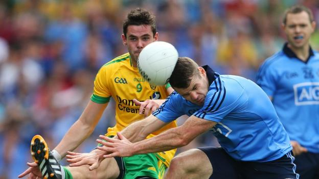 Odhran Mac Niallais and Kevin McManamon compete for the ball during a fiercely contested semi-final