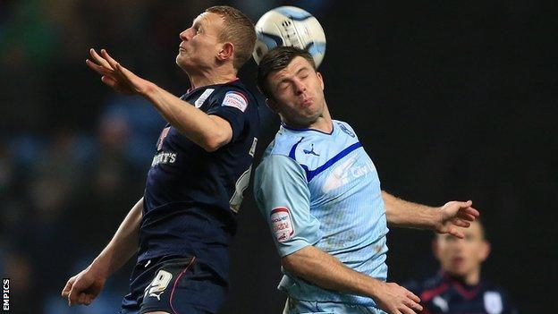Stuart Beavon (left) challenges Coventry City's Steven Jennings