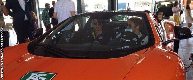 Cristiano Ronaldo gets a driving lesson from Jenson Button