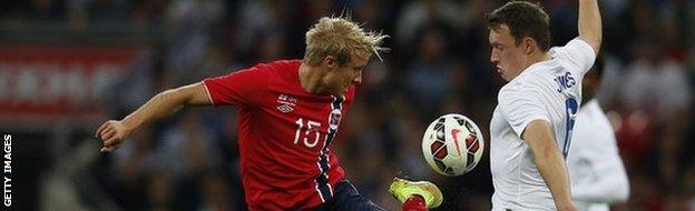 England's Phil Jones and Norway's Per Ciljan Skjelbred