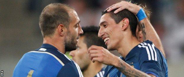 Argentina's Angel Di Maria (right) celebrates scoring against Germany