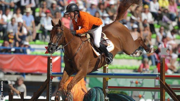 Netherlands' Gerco Schroder rides Glock's London NOP during the Individual Jumping competition of the 2014 FEI World Equestrian Games