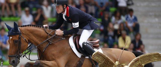 Britain's rider Scott Brash on horse Hello Sanctos competes in the Jumping First Competition
