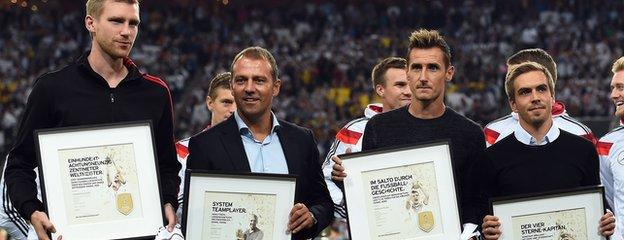 Per Mertesacker (left) Miroslav Klose (second from right) and Philipp Lahm (right)