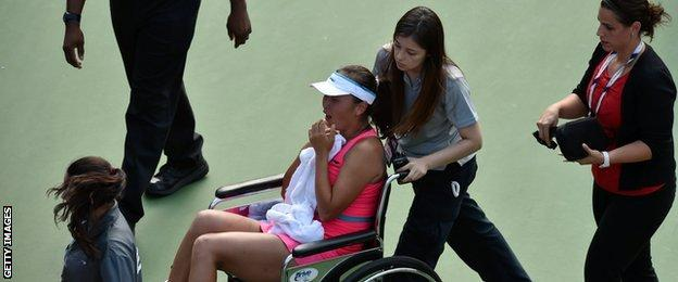 Peng Shuai had to be taken off the court in a wheelchair