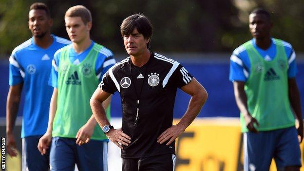 Germany coach Joachim Low watches his players in training