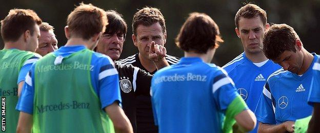 Germany coach Joachim Low issues instructions to his players in training