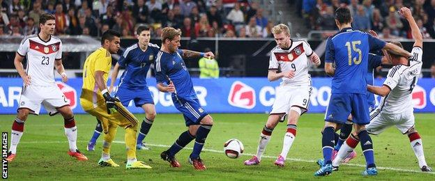 Andre Schurrle scores for Germany against Argentina