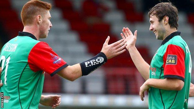 Kym Nelson and Fra McCaffrey celebrate Glentoran's early goal against Coleraine