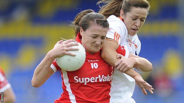 Cork's Annie Walsh is tackled by Armagh opponent Caroline O'Hanlon