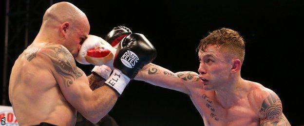 Carl Frampton (right) in action against Kiko Martinez