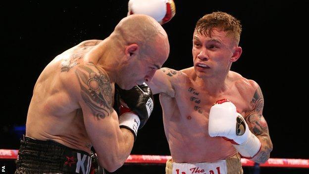 Carl Frampton (right) lands a heavy right-hander on Kiko Martinez