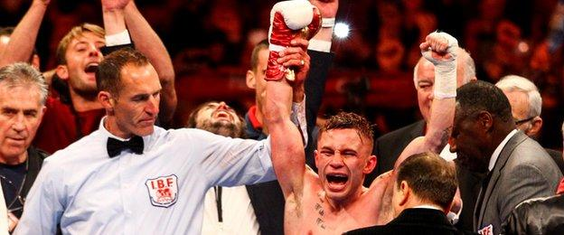 Carl Frampton celebrates after being announced as the new world IBF super-bantamweight champion