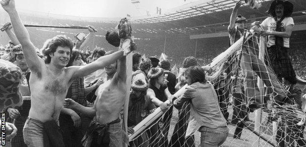 The Scotland fans break the crossbar at Wembley in 1977 after watching their side win 2-1