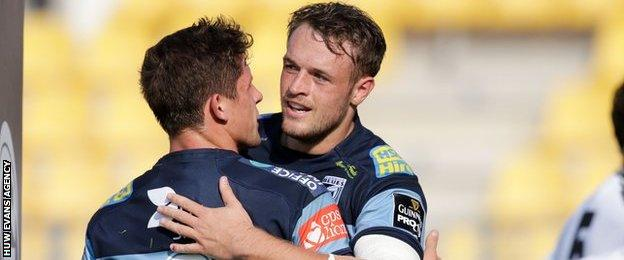 Lloyd Williams is congratulated by Cory Allen after scoring